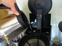 Refilling the coffee maker