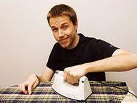 Happy guy ironing