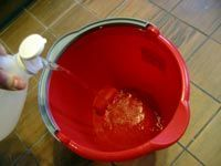 filling a bucket with vinegar