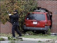 car crashed through brick wall