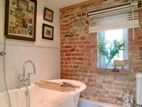 brick wall in bathroom