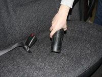 Vacuuming the car seats