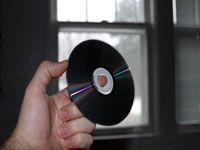 holding up a compact disc