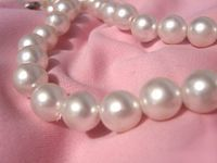 pearls on a pink cloth