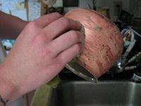 scrubbing outside of copper pot