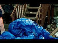 blue tarp over deck items