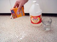 pouring baking soda on stain