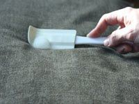using a rubber scraper on upholstery