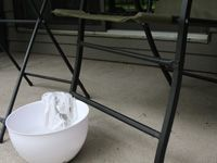 bowl of cleaner in front of patio furniture