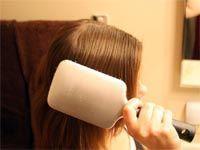 person brushing hair