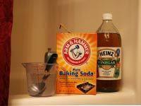 box of baking soda and jar of vinegar