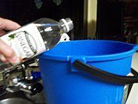 pouring vinegar into bucket