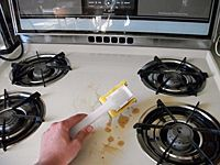 scraping up kitchen grease