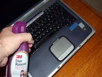 canned air spraying laptop