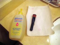 baby shampoo and makeup brush on paper towel