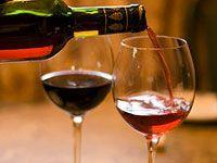 filling up wine glasses