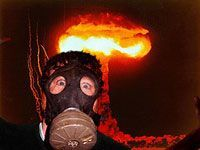 guy in gas mask in front of nuclear explosion