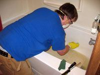 Guy in mask and rubber gloves scrubbing