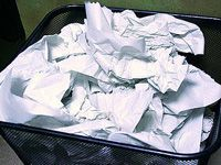 garbage can full of paper