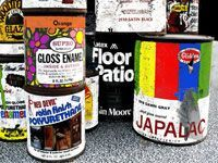 cans of old latex paint