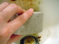 scrubbing with pumice stone