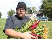 guy with lots of vegetables in his arms