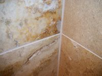 badly stained travertine