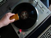brushing the vinyl record