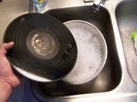 vinyl record in soapy water