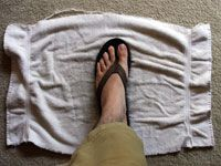 stepping on towel to increase soaking