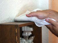 Wiping dust off a shelf