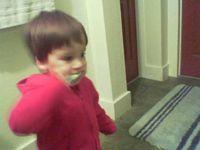 little kid brushing teeth