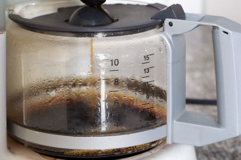 A coffee maker brewing coffee.
