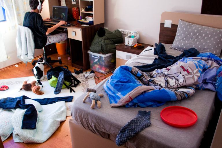 A teenager's messy bedroom.