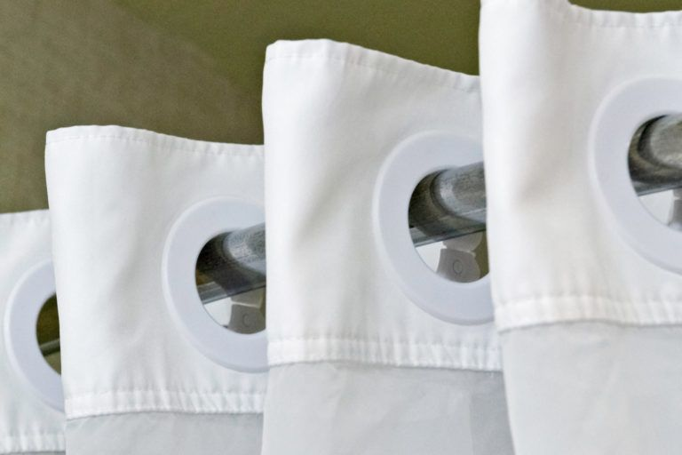 A white shower curtain.