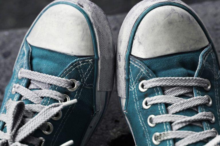 Dirty blue sneakers.