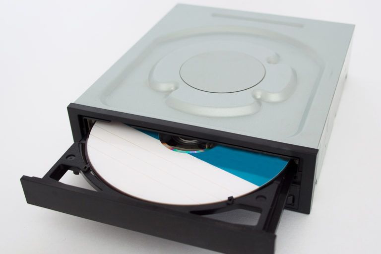 A CDROM drive partially open with a disc inside.
