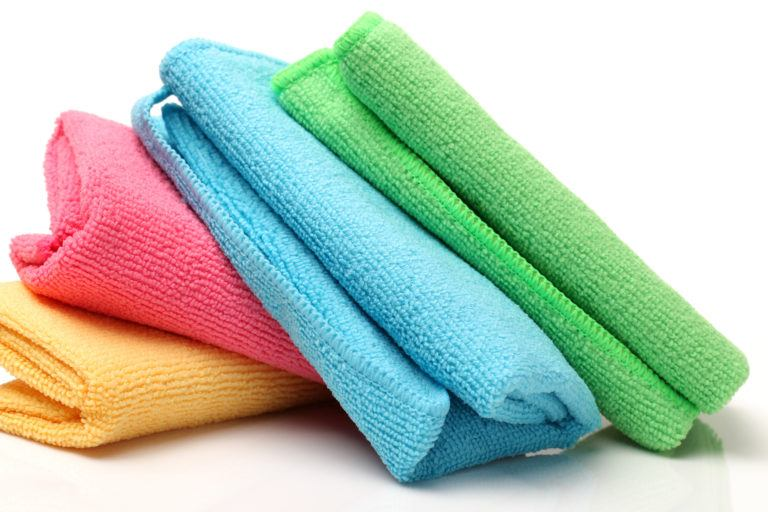 Four microfiber clothes of various colors.