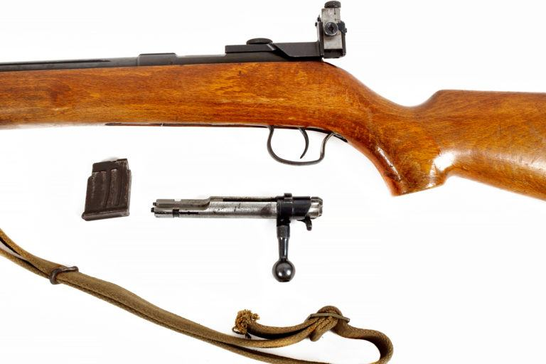A bolt action rifle on a white background.