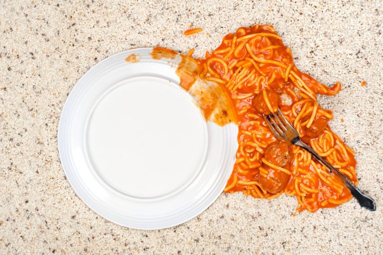 A plate of spaghetti dropped onto carpet.